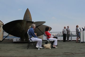 Supporters of the SS United States Conservancy gather on the deck of the ship to celebrate the $120,000 donation that saved the ship's last propeller. (Emma Lee/WHYY)