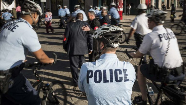 Philadelphia police escort a protest march near City Hall. (Branden Eastwood for NewsWorks)