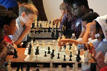 More than 200 children from 23 Philadelphia schools converge at Independence Seaport Museum for a taste of tournament chess. (Emma Lee/WHYY)