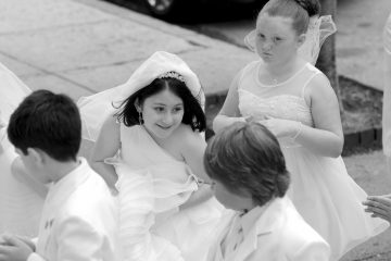 As they enter the church for their First Communion, children smile and talk quietly. (Peter Tobia/for NewsWorks)