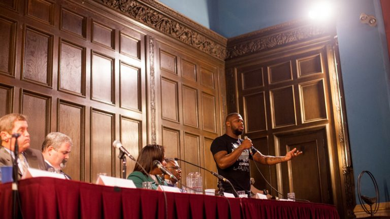 Joshua Glenn speaks at a forum on ending the cash bail system in Philadelphia Thursday at the First Unitarian Church. Glenn was held for 18 months when he was 16 after not being able to post bail. (Brad Larrison for NewsWorks)
