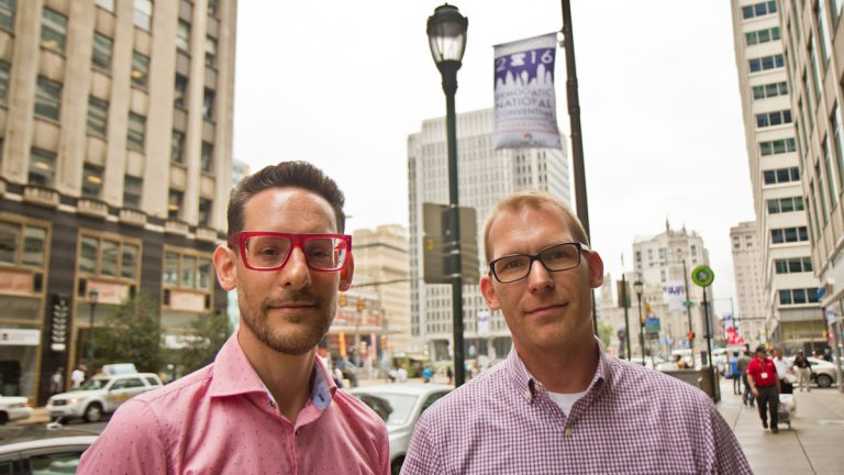 Concerned LGBT citizens Christopher M. Whibley and Tyler Lynch have a plan to block the message of the Westboro Baptist Church during the DNC. (Kimberly Paynter/WHYY)