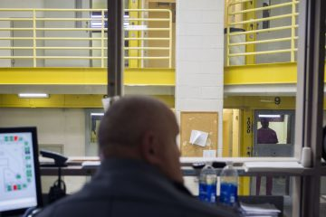 Corrections Officer Gregory Kulp monitors inmates at Lehigh County Jail in Allentown