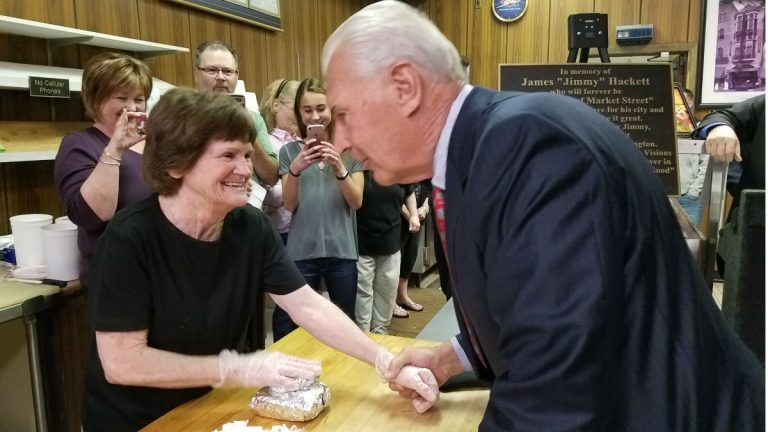 Wilmington Mayor Mike Purzycki buys the final sandwich at Leo and Jimmy's Deli on Market St. Friday afternoon. (Andrea Gibbs/WHYY)