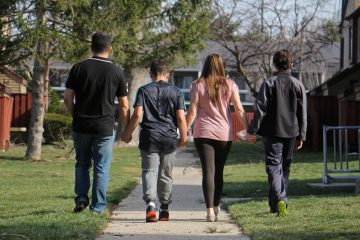 A Costa Rican family walks near their home in South Jersey. (Emma Lee/WHYY)
