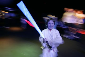A young boy is shown holding his light sabre at a 2007 Star Wars-themed event in London. (AP Photo/Alastair Grant, file)