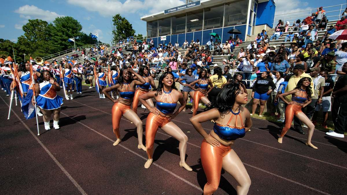 Lincoln University cheerleaders perform in front of the Cheyney stands. Enrollment at Lincoln is up, while Cheyney numbers are falling, but both schools suffer from funding shortages. (Bastiaan Slabbers/for NewsWorks)
