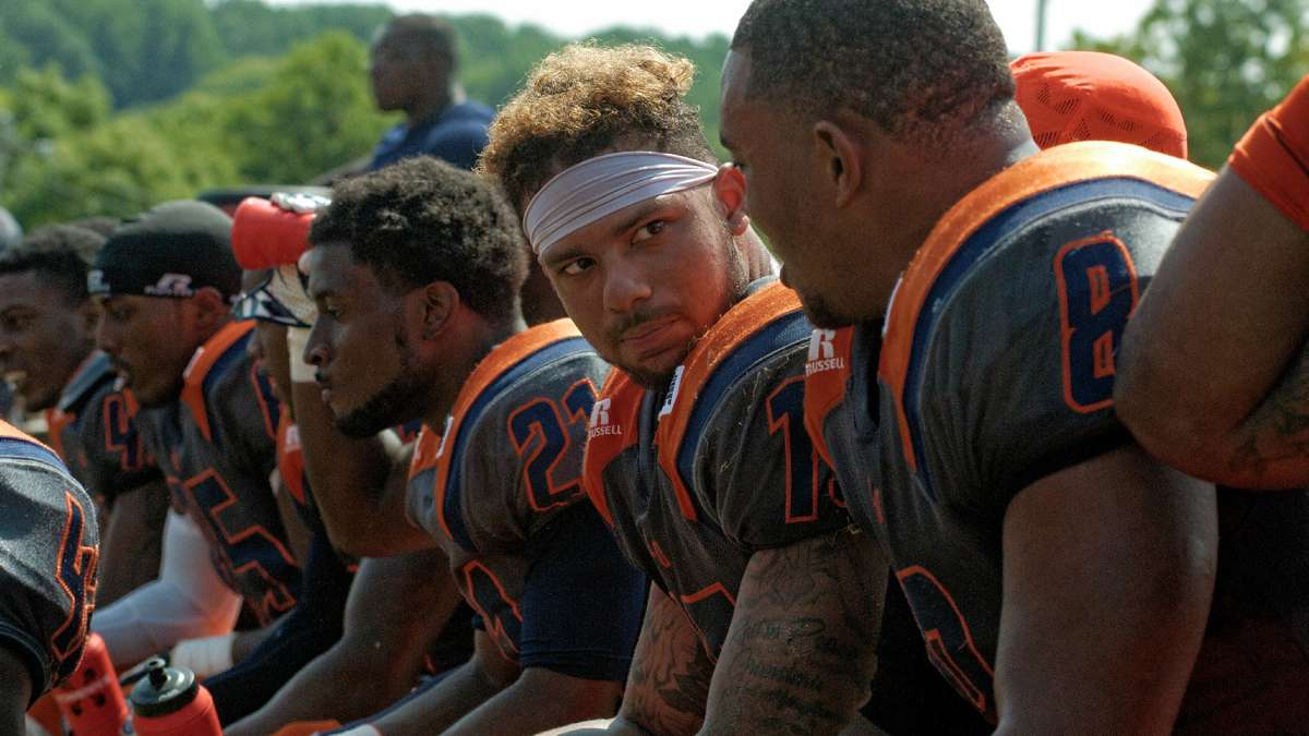 Lincoln footbal players confer on the bench during the contest against Cheyney. (Bastiaan Slabbers/for NewsWorks)