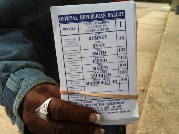 Sample ballots handed out on Germantown Avenue. (Kiera Smalls/for WHYY, file)