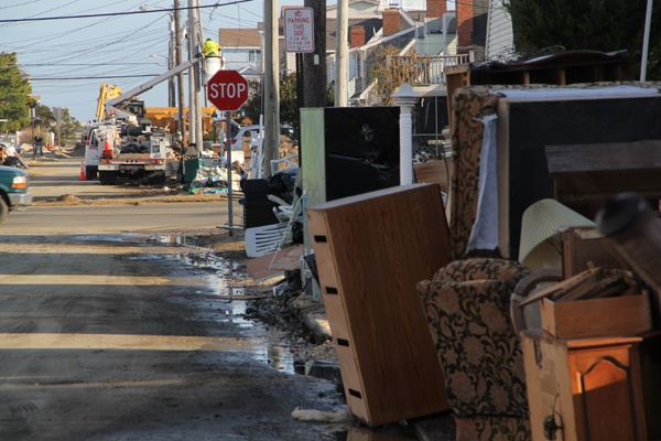 <p><p>Displaced and discarded appliances and furniture are piled at the curb at Sand Dune Lane and Long Beach Boulevard in Long beach, N.J. (Emma Lee/for NewsWorks)</p></p>