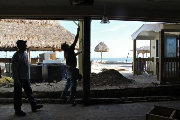 <p><p>Workers clean up the damaged Sea Shell Resort and Beach Club in Beach Haven, N.J. The club's owner said he objected to dune building because it spoiled the view. (Emma Lee/for NewsWorks)</p></p>
