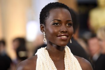 Lupita Nyong'o arrives at the Oscars on Sunday, Feb. 22, 2015, at the Dolby Theatre in Los Angeles. (Photo by Chris Pizzello/Invision/AP)