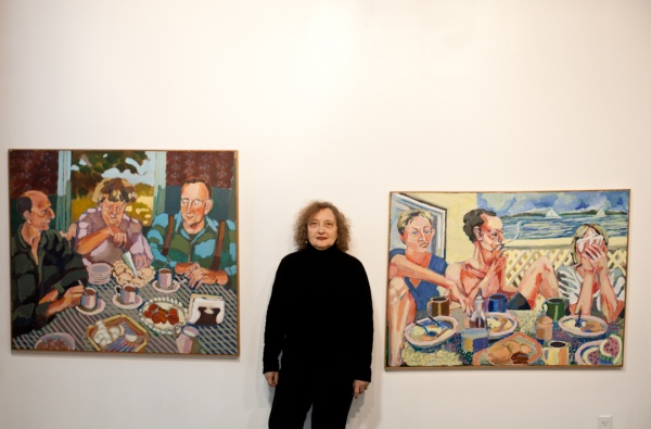 "<p><p>Doris Lane Grey standing between her paintings, ""Apple Pie Brunch"" (left) and ""Stone Harbor Brunc"" (right) at the Mt. Airy Art Garage. (Brad Larrison/for NewsWorks)</p></p>"