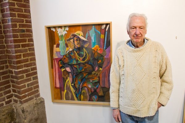 """<p><p>Bob Finch stands next to his painting, titled """"Cynthia,"""" a portrait of his friend of the same name who Finch says is, """"an inspiring person.""""(Brad Larrison/for NewsWorks)</p></p>"""