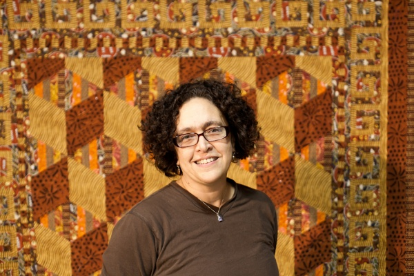 <p><p>Sarah Bond stands in front of one of her quilts displayed in the Mt. Airy Art Garage. Bond has been quilting for 30 years. She says it runs in the family and that she is carrying on the tradition. (Brad Larrison/for NewsWorks)</p></p>