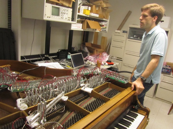 The electromagnet rigging is portable can be removed from the old, battered piano in Drexel's music and entertainment technology lab and reinstalled in a concert grand in a few hours. (Peter Crimmins/For NewsWorks)