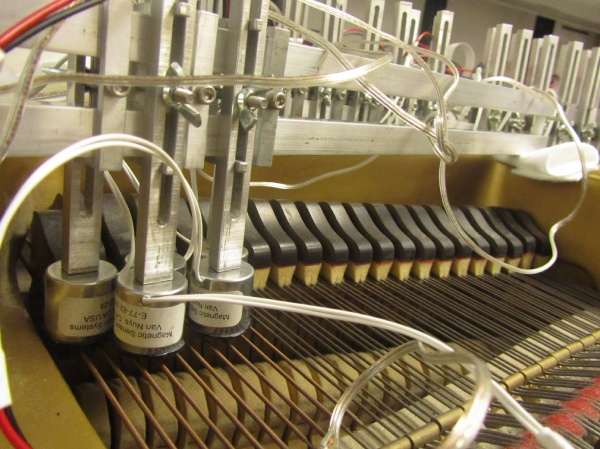 The MRP is a standard piano rigged with electromagnets a fraction of an inch above each of its strings. (Peter Crimmins/For NewsWorks)
