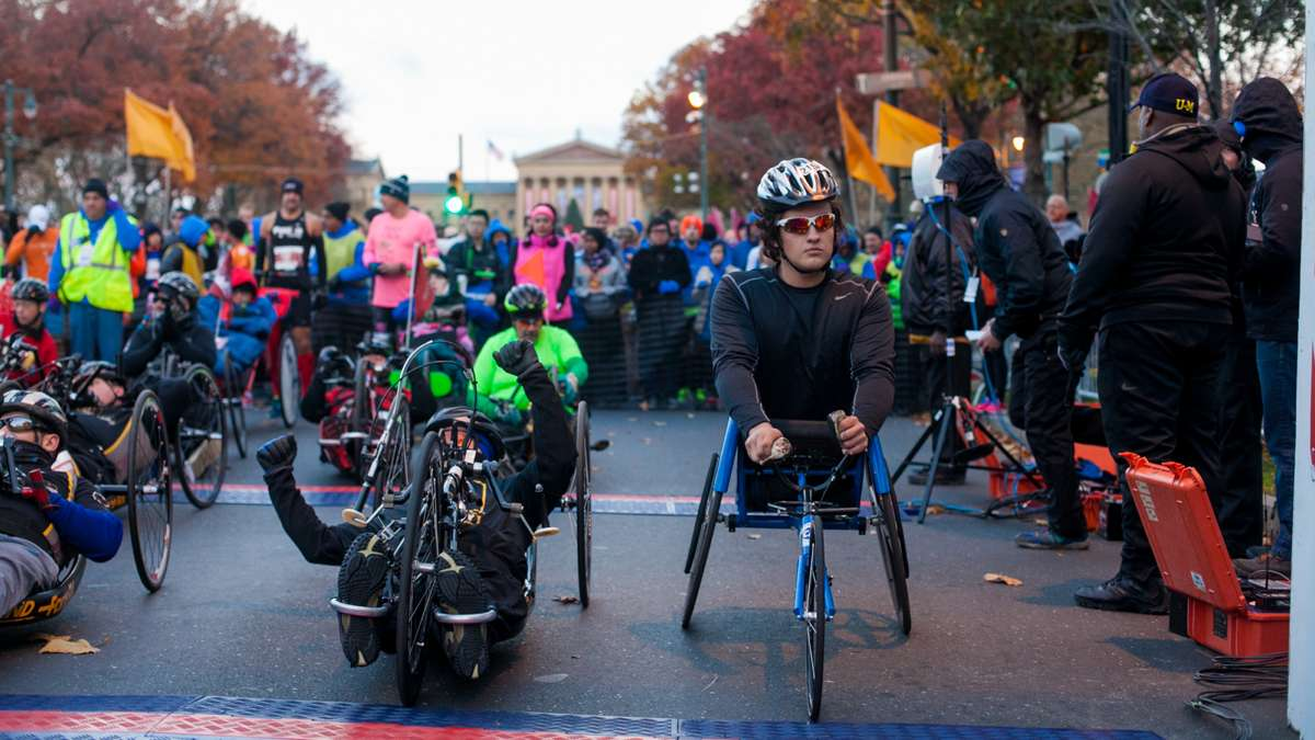 Wheelchair and handcycle competitors wait for the start of the Philadelphia Marathon.