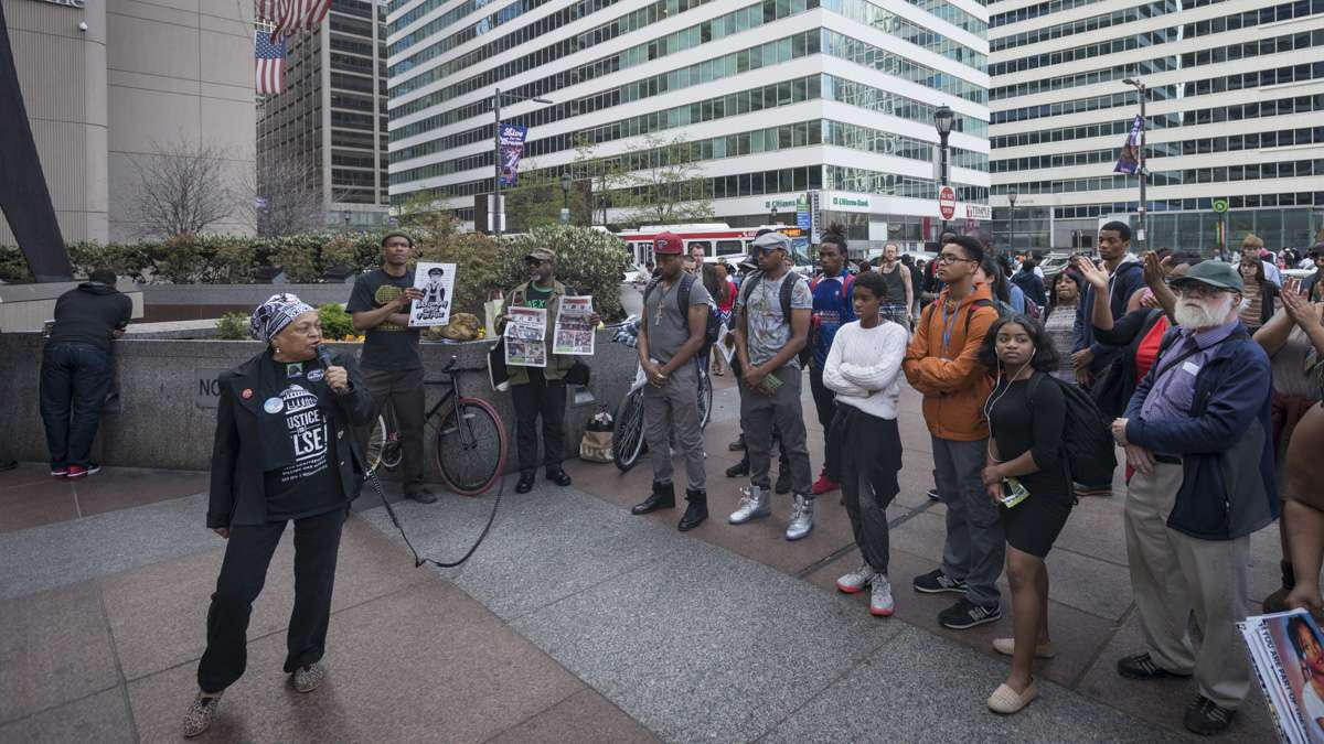 Pam Africa, a member of the MOVE Organization that was famously bombed by the Philadelphia police in 1985, speaks at a rally marking the one year anniversary of the death of Freddie Gray whose spinal cord was severed while in police custody. (Branden Eastwood for NewsWorks)