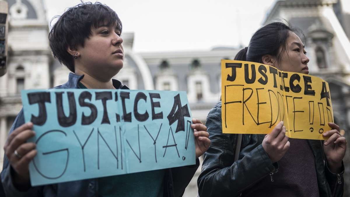 Dimi Xepapadeas (left) and Victoria Yu hold signs seeking justice for Gynnya Mcmillen and Freddie Gray, both of whom were young African Americans that died in police custody. When asked about what drew her to the case of Freddie Gray, Yu said, 'For me it's very clearly an injustice and needs to be spoken about.'