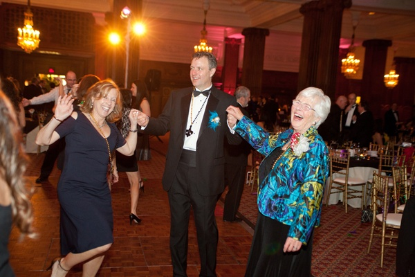 <p><p>2013 Charley and Peggy Roach award recipient Madge Keehn (right) dancing with her son, EFEPA board member Paul Keehn, and his wife, Abby (Photo courtesy of Photos by Jonathan Meter)</p></p>