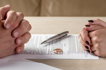 (<a href='https://www.bigstockphoto.com/image-148684790/stock-photo-hands-of-wife-and-husband-signing-divorce-documents-or-premarital-agreement'>Krivinis</a>/Big Stock Photo)