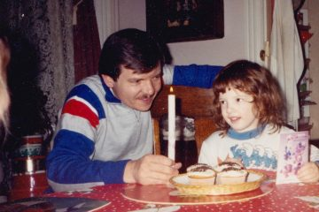 The author celebrates her 5th birthday. Her Dad, James Rusek, is holding the candle. (Image courtesy of Marta Rusek)