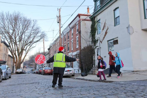 <p><p>Nominated Crossing Guard Mary Evans crosses children at the corner of Smick and Hermitage street in Manayunk. (Kimberly Paynter/WHYY)</p></p>