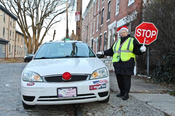 <p><p>Nominated Crossing Guard Mary Evans stands with her car decked out as Rudolph at Hermitage and Smick streets in Manayunk. (Kimberly Paynter/WHYY)</p></p>