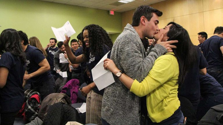 Kelsie Persaud and her fiancé celebrate Persaud's match for her residency. (Kimberly Paynter/WHYY)