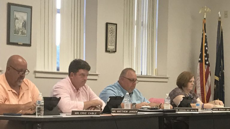 Matthew Jansen (second from the left) officially resigned as Spring Grove Area School District director. (Emily Previti/WITF)