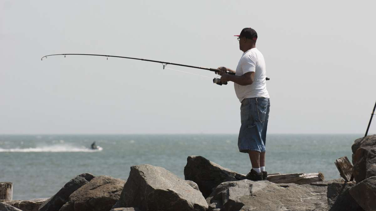 Jose Martinez fishes in the Inlet section of Atlantic City, Memorial Day weekend, Saturday, May 28, 2016.