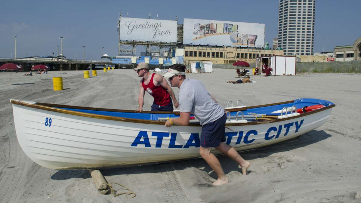 Atlantic City Beach Patrol Life Guards, Connor Maher and Andrew Light, ready a life boat at the South Carolina beach to start Memorial Day weekend, Saturday, May 28, 2016.