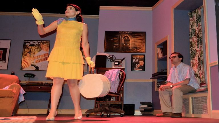 """Nancy (Julia Wise) happily delivers bad news to former husband Allan Felix (James Lewis) in a scene from The Stagecrafters Theater's production of """"Play it Again, Sam."""""""