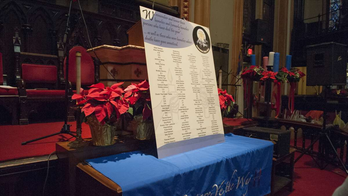 A sign with the names of more than 100 deceased homeless men and women sits on the altar of the Arch Street United Methodist Church. (Jonathan Wilson/for NewsWorks)