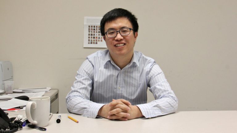 Meng Li, a professor of business science at Rutgers Camden, is an H-1B visa holder. (Emma Lee/WHYY)