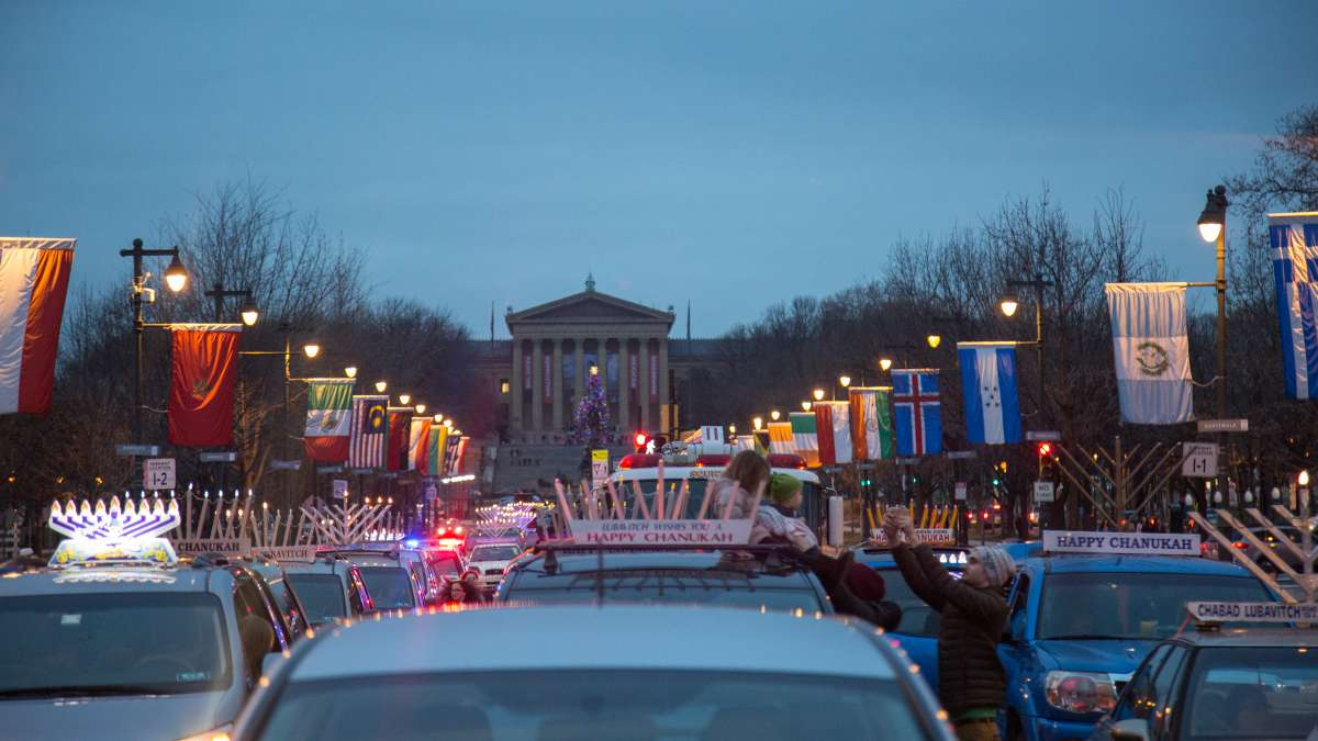 More than 250 cars gather on the Ben Franklin Parkway for the 10th Annual Car Menorah Parade December 26, 2016.