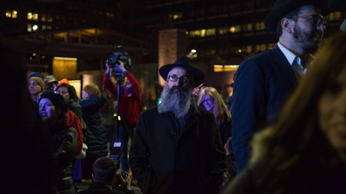 A crowd gathers on Market Street to watch the lighting of the massive menorah on Independence Mall for the third night of Hanukkah, December, 26, 2016.