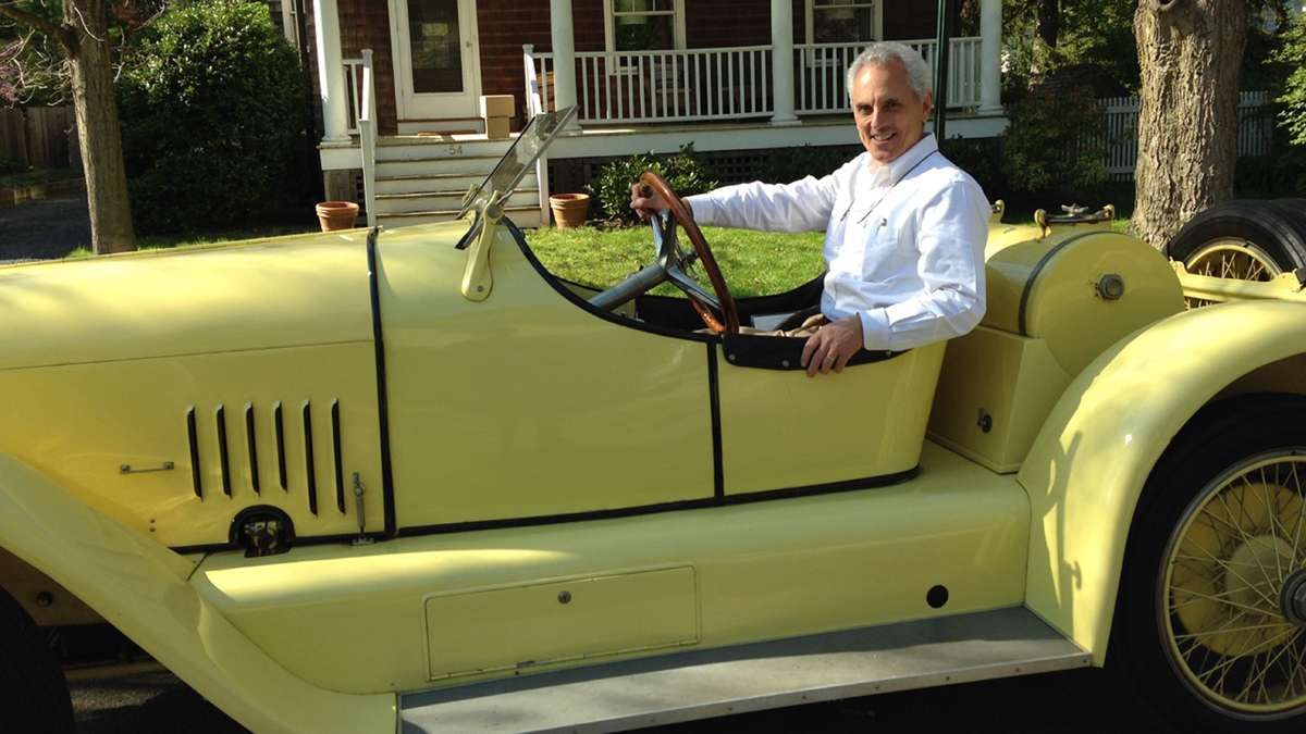 Author Clifford Zink is pictured here in a 1920, canary yellow, L-Head Mercer Raceabout owned by a Princeton, New Jersey vintage car aficionado.