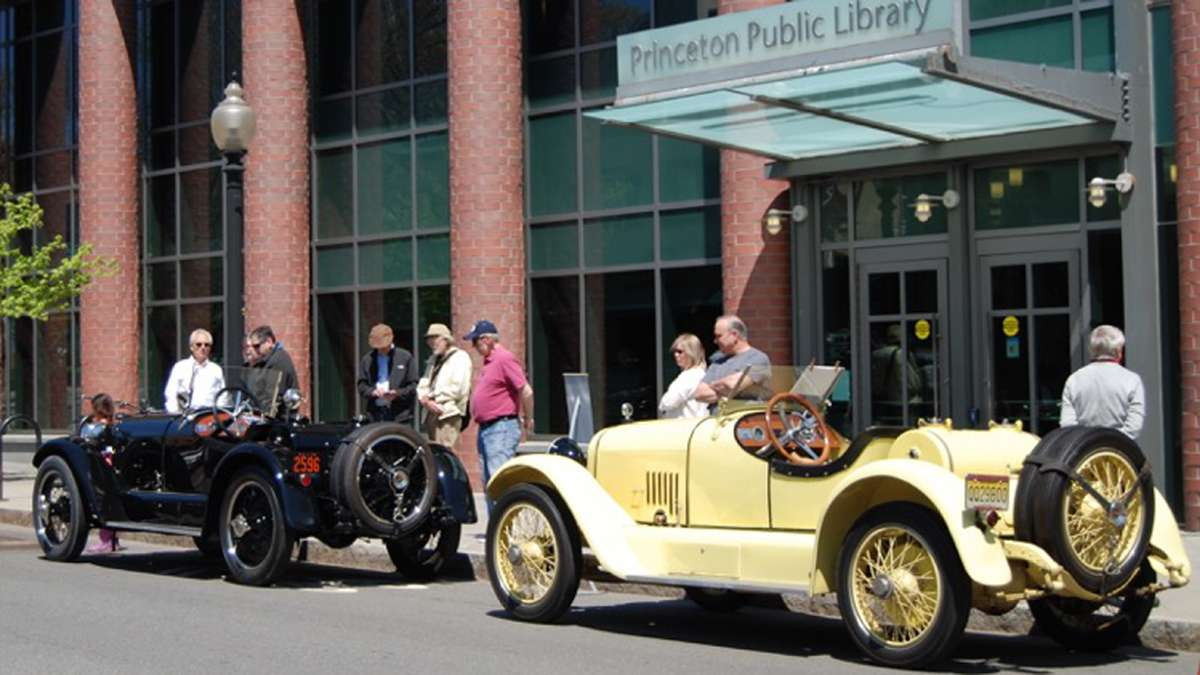Two L-Head Mercer Raceabouts, canary yellow (1920) and black (1923), parked outside the Princeton Public Library.