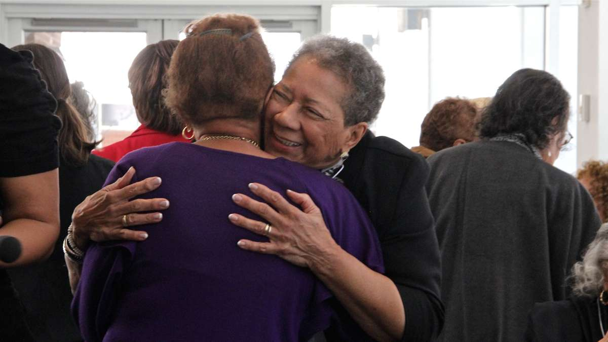 Mercy Douglass Alumni Association President Elizabeth Williams greets a former classmate at a tea honoring graduates of the historically black nursing school. (Emma Lee/for NewsWorks)