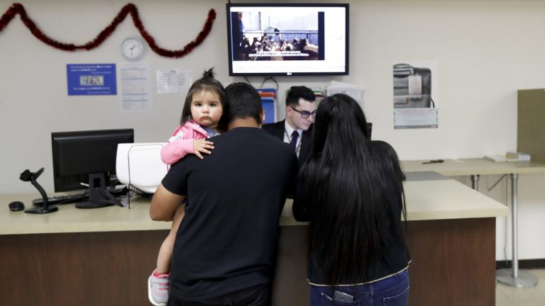 An official for the Consulate General of Mexico works with a family Friday, March 3, 2017, in San Diego, Calif. Mexican officials created of a new network aimed at informing and advocating for Mexicans living in the United States. The network, called the Mexican Defense Center, will bolster work for Mexicans at 50 consulates around the country, including Philadelphia. (AP Photo/Gregory Bull)