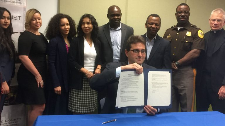 County Executive Matt Meyer signed an executive order that aims to protect the immigrant community. (Zoë Read/WHYY)