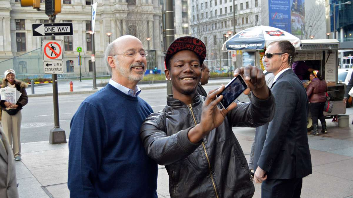 Tom Wolf stops for a selfie while strolling Center City on election morning. (Tom MacDonald/WHYY)
