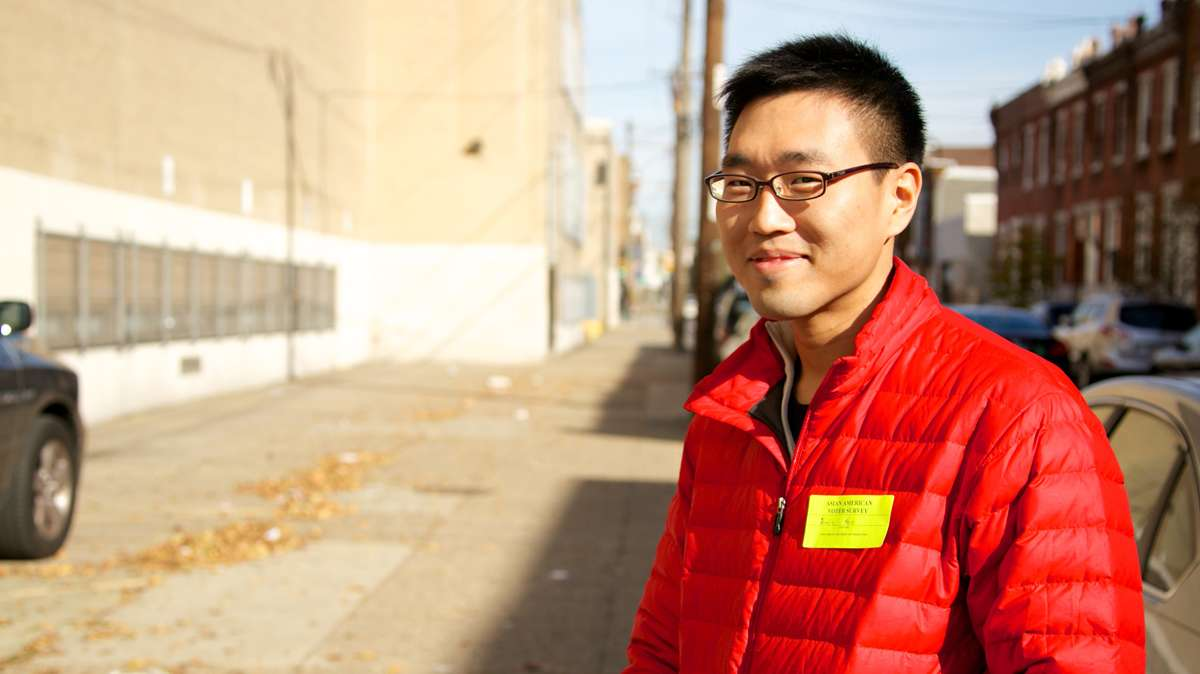 Jamin Koo was at the Philadelphia High School Polling location, surveying any problems with communication amongst the Asian voters and the voting process. (Nathaniel Hamilton/for NewsWorks)