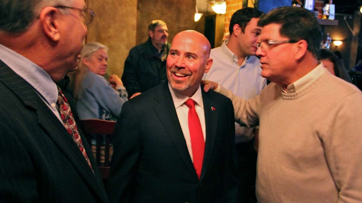 Tom MacArthur (center), who is running to fill the 3rd District Congressional seat being vacated by former Eagle Jon Runyan, is received affectionately by fellow republicans at Marlton Tavern in Burlington County as his campaign draws to a close. (Emma Lee/WHYY)