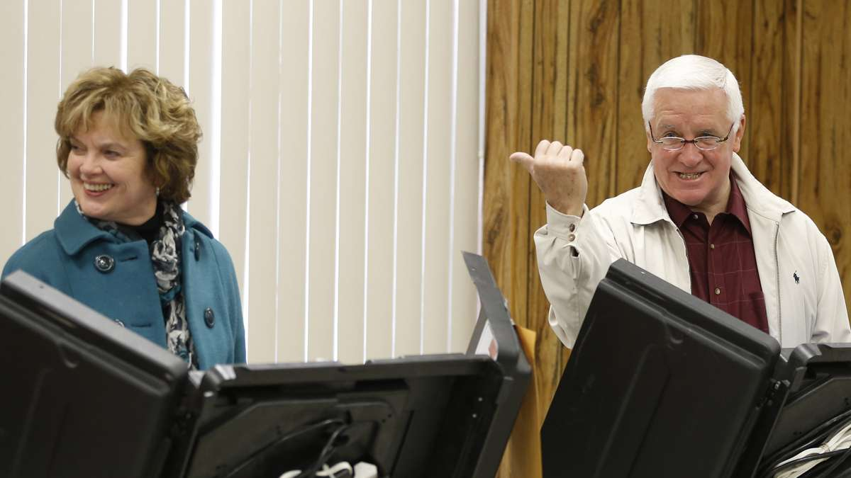 Pennsylvania Governor Tom Corbett jokes with photographers as he casts his vote in Shaler Township, Pa. on Tuesday, Nov. 4, 2014. (Keith Srakocic/AP Photo)