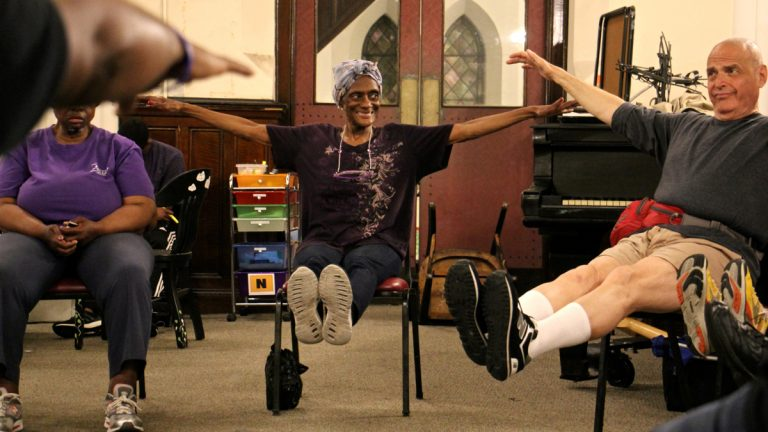 Miss Dee (center) participates in a dance and movement class at the Broad Street Ministry. (Emma Lee/WHYY)