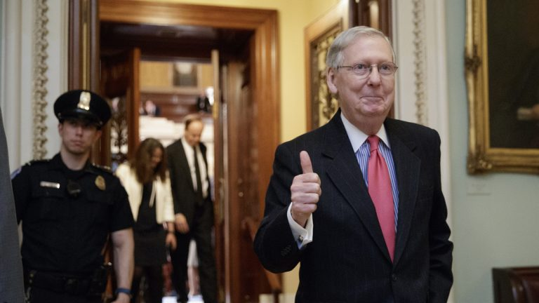 Senate Majority Leader Mitch McConnell, R-Ky., signals a thumbs-up as he leaves the chamber after he led the GOP majority to change Senate rules and lower the vote threshold for Supreme Court nominees from 60 votes to a simple majority in order to advance Neil Gorsuch to a confirmation vote. (AP Photo/J. Scott Applewhite)
