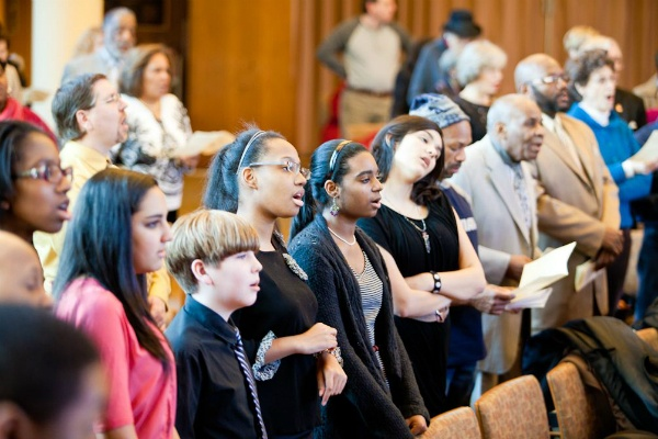 <p><p>Members of the Second Baptist Church Youth Choir sing along to a song before their own performance during an MLK-inspired interfaith service at Germantown Jewish Centre in Mount Airy. (Brad Larrison/for NewsWorks)</p></p>